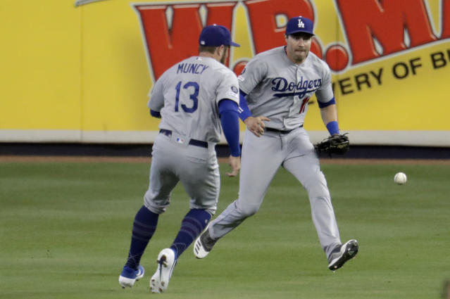 Los Angeles Dodgers second baseman Max Muncy (13) and center fielder A.J. Pollock, right, can't get to a ball hit by Miami Marlins' Brian Anderson for a RBI single during the first inning of a baseball game, Thursday, Aug. 15, 2019, in Miami. (AP Photo/Lynne Sladky)