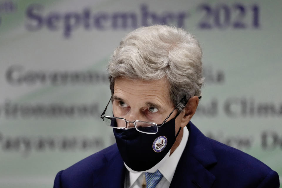 In this Sept. 13, 2021 photo, U.S. Special Presidential Envoy for Climate John Kerry listens to a speech at the launch of Climate Action and Finance Mobilisation Dialogue (CAFMD) under India-US Agenda 2030 Partnership in New Delhi, India. Kerry's quest to stave off the worst scenarios of global warming is meeting resistance from China, the world's biggest climate polluter, which is adamant that the United States ease confrontation over other matters if it wants Beijing to speed up its climate efforts. (AP Photo/Manish Swarup)