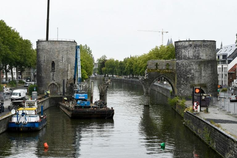 Tournai authorities insist they chose the most cost-effective option to build a new crossing that will allow larger barges to sail underneath while preserving the medieval monument's character (AFP Photo/JOHN THYS)