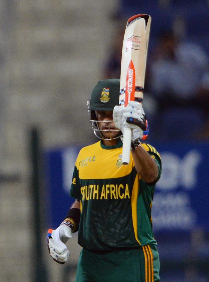 South African batsman JP Duminy wave his bat after making fifty runs during the third day-night international in Sheikh Zayed Cricket Stadium in Abu Dhabi on Novemver 6, 2013. South African captain AB de Villiers won the toss and decided to bat in the first. The five-match series is tied at 1-1. AFP PHOTO/ Asif HASSAN        (Photo credit should read ASIF HASSAN/AFP/Getty Images)