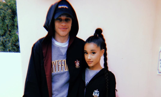 Ariana Grande and Pete Davidson in Hogwarts robes. (Photo: Pete Davidson via Instagram)