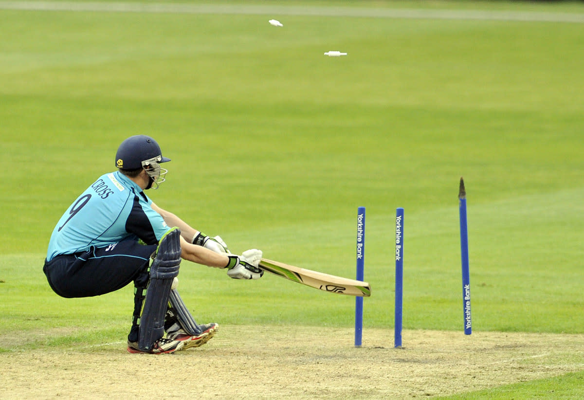 MANCHESTER, ENGLAND - JUNE 18:  Matthew Cross of Scottish Saltires is bowled out during the Yorkshire Bank 40 match between Lancashire Lightning and Scottish Saltires at Old Trafford on June 18, 2013 in Manchester, England. (Photo by Clint Hughes/Getty Images)