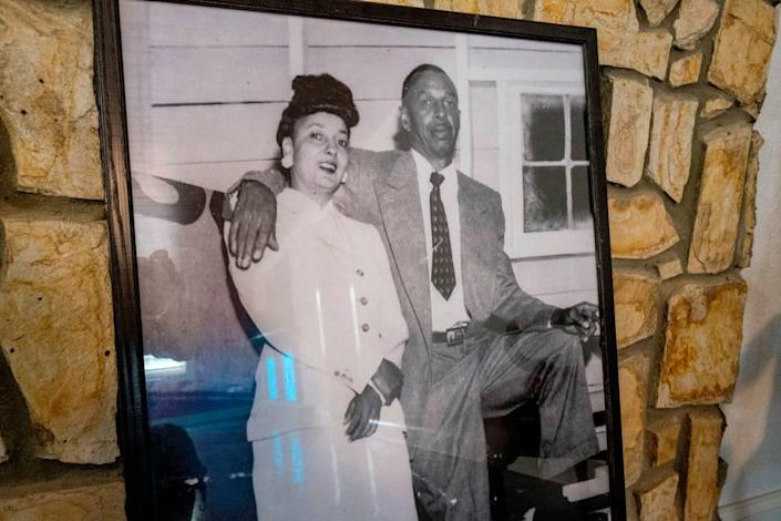 A framed photo of Charlie Fitzgerald and his wife Sarah inside their ols home that has been renovated by the city.