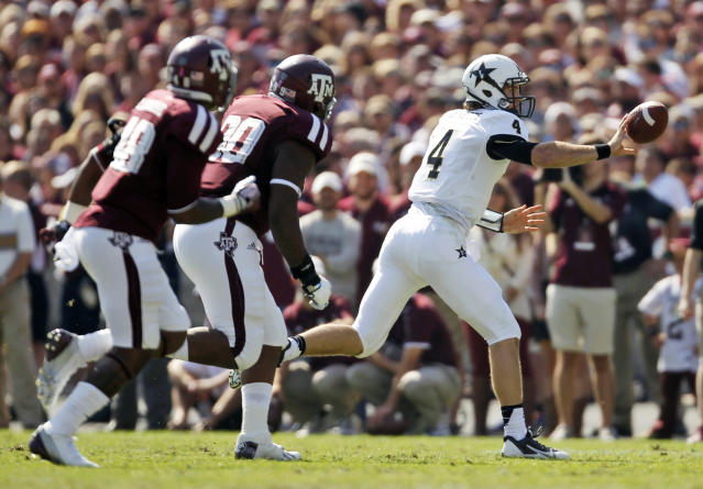 Vanderbilt's Patton Robinette (4) throws a shuffle pass during the first half of an NCAA football game against Texas A&M, Saturday, Oct. 26, 2013, in College Station, Texas. (AP Photo/Eric Christian Smith)