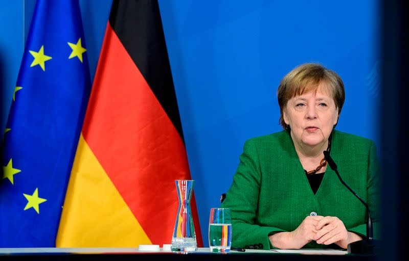 FILE PHOTO: German Chancellor Angela Merkel attends a video-conferenced meeting with representatives of the German Association of Local Utilities of municipally determined infrastructure undertakings and economic enterprises in Berlin