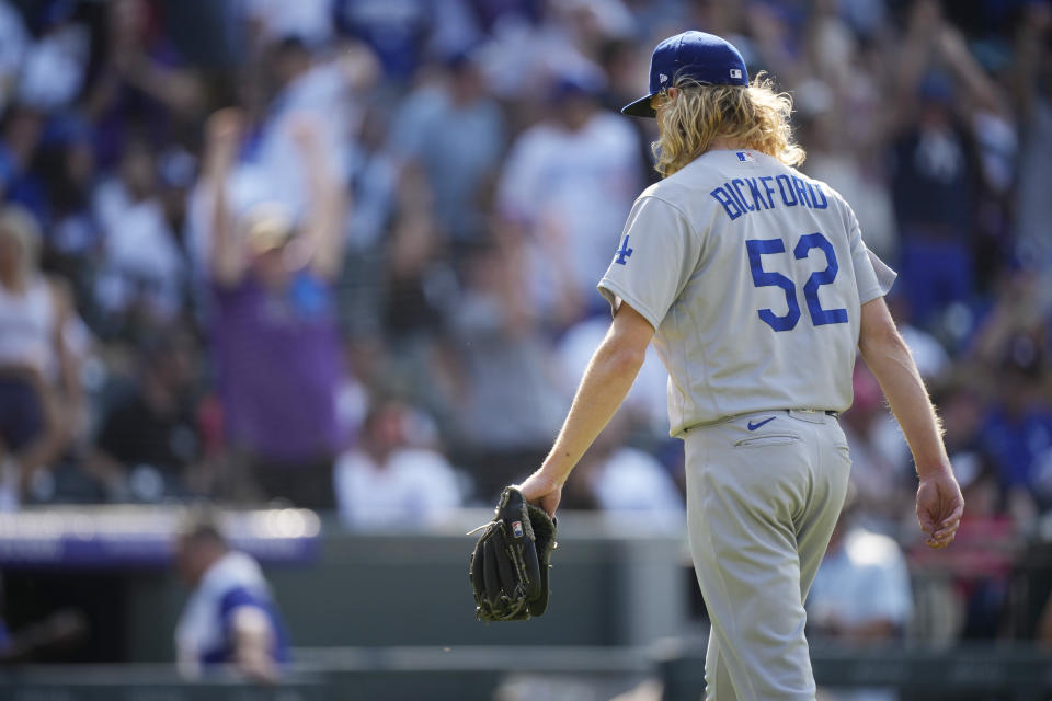 Los Angeles Dodgers relief pitcher Phil Bickford heads to the dugout after giving up a solo walkoff home run to Colorado Rockies' Charlie Blackmon in the 10th inning of a baseball game Sunday, July 18, 2021, in Denver. (AP Photo/David Zalubowski)