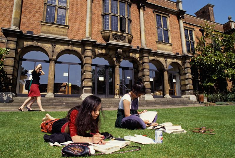 Students studying in the sunshine at Somerville College, Oxford.   - Credit: Alamy