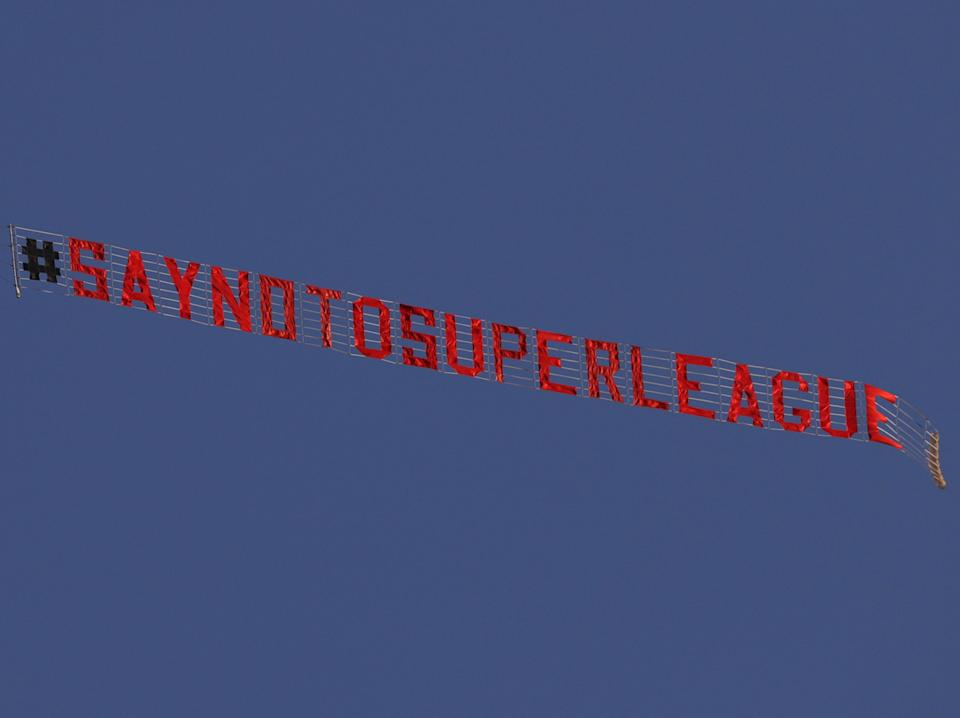 <p>A banner flown above Elland Road in March</p> (POOL/AFP via Getty Images)
