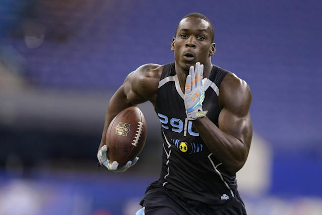 Florida State linebacker Telvin Smith runs a drill at the NFL football scouting combine in Indianapolis, Monday, Feb. 24, 2014. (AP Photo/Michael Conroy)