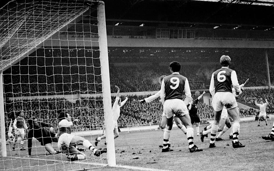 Cooper wheels away after scoring the only goal of the 1968 League Cup final against Arsenal - PA