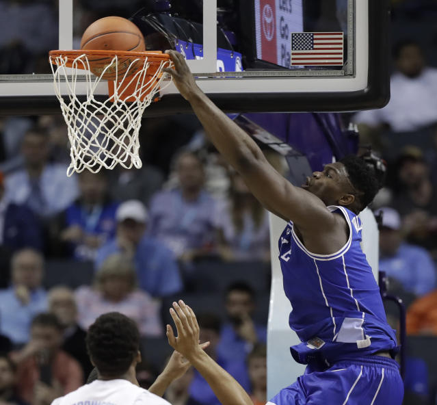 Zion Williamson (1) dunks during the second half of an NCAA college basketball game against North Carolina in the Atlantic Coast Conference tournament in Charlotte, N.C., Friday, March 15, 2019. (AP Photo/Chuck Burton)