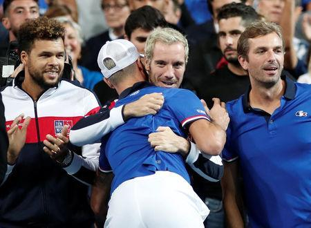 Tennis - Davis Cup - World Group Semi-Final - France v Spain - Stade Pierre Mauroy, Lille, France - September 14, 2018 France's Benoit Paire celebrates with teammate Richard Gasquet after winning his match against Spain's Pablo Carreno Busta REUTERS/Benoit Tessier