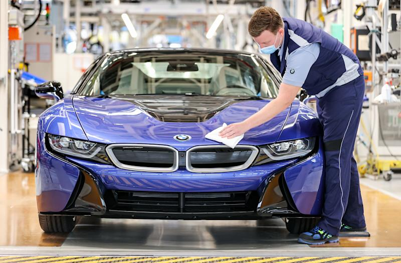 11 June 2020, Saxony, Leipzig: At the end of the production line, an employee walks over the last BMW i8 with a cloth. Six years after its market launch, the last plug-in hybrid sports car has rolled off the assembly line here. A total of 20 488 of these cars were produced at the Leipzig plant. This makes the hybrid sports car with electric and gasoline engines by far the best-selling sports car at BMW. The vehicle with a passenger cell made of carbon-reinforced plastic (CFRP) won numerous awards. In addition to vehicles with combustion engines, BMW also builds the electric model i3 in Leipzig. Photo: Jan Woitas/dpa-Zentralbild/dpa (Photo by Jan Woitas/picture alliance via Getty Images)
