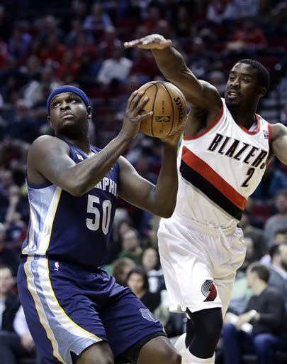 Memphis Grizzlies forward Zach Randolph, left, looks to shoot as Portland Trail Blazers guard Wesley Matthews attempt to block from behind during the first quarter of an NBA basketball game in Portland, Ore., Wednesday, April 3, 2013.(AP Photo/Don Ryan)