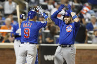 Chicago Cubs' Victor Caratini, right, celebrates with teammate Javier Baez (9) after Baez and Kris Bryant also scored on his seventh-inning three-run home run during a baseball game against the New York Mets, Thursday, Aug. 29, 2019, in New York. (AP Photo/Kathy Willens)