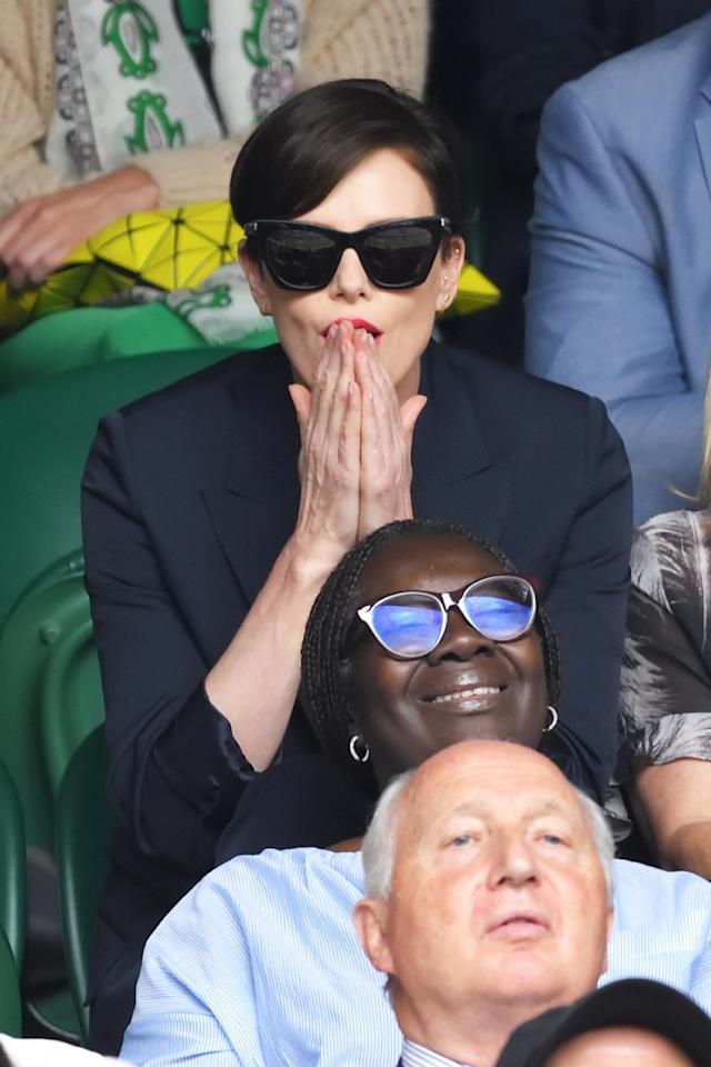 Charlize Theron is on the edge of her seat during the men's final of the Wimbledon Tennis Championships at the All England Lawn Tennis and Croquet Club on Sunday in London.