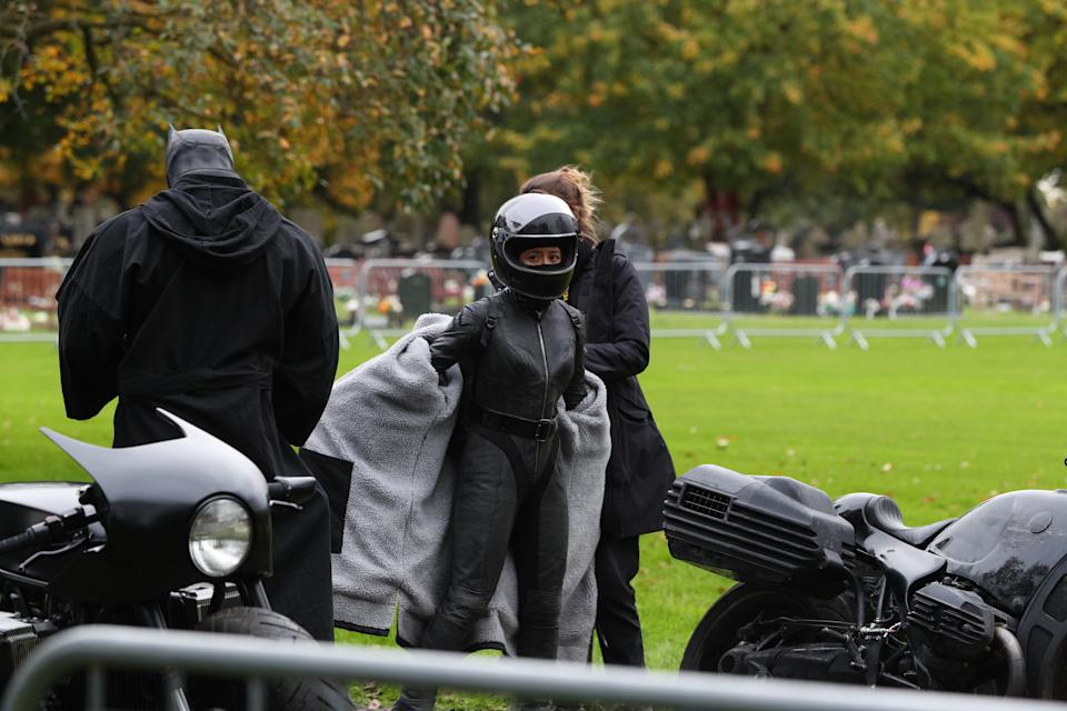 A woman prepares to get on a motorbike during the filming of The Batman taking place in Liverpool.