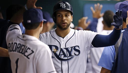 Tampa Bay Rays' James Loney, center, is congratulated by teammate, including Sean Rodriguez, after his two-run home run during the second inning of an interleague baseball game against the San Diego Padres Saturday, May 11, 2013, in St. Petersburg, Fla. (AP Photo/Mike Carlson)