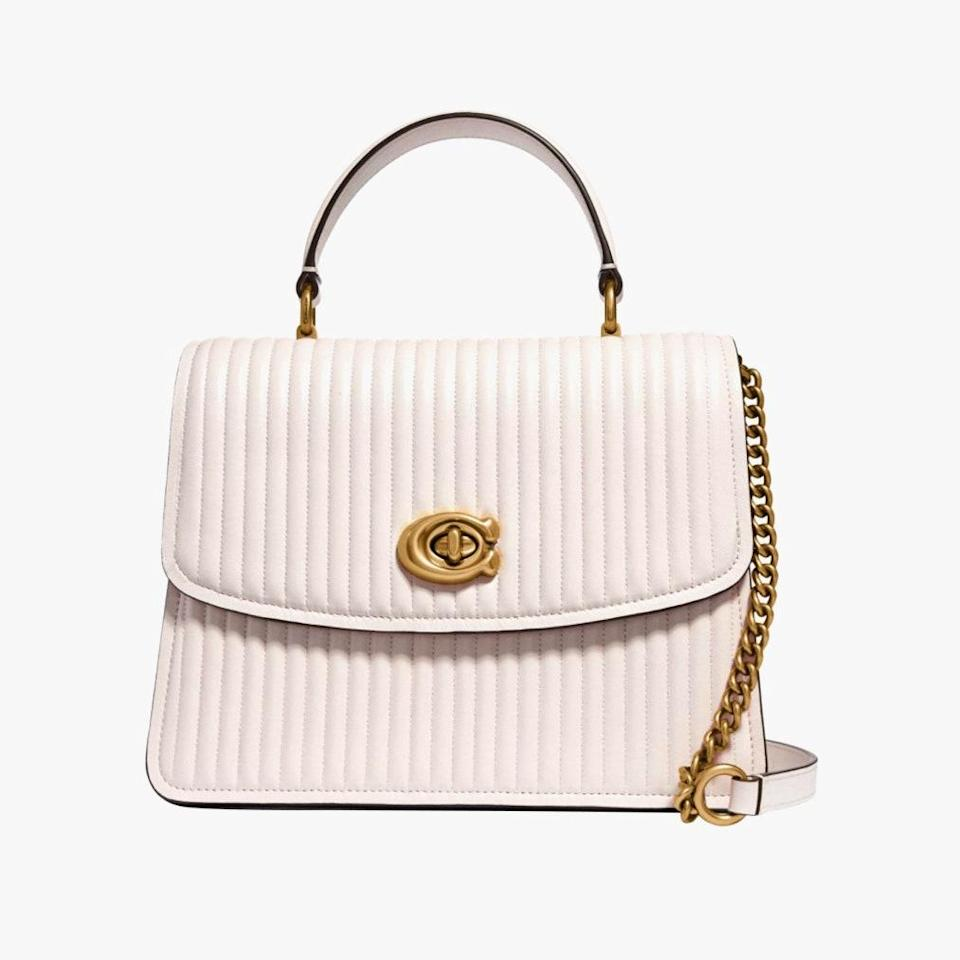 "Here's a designer handbag that's not too small and not too big, which makes it perfect to wrap up this holiday season. $450, COACH. <a href=""https://www.coach.com/coach-parker-top-handle-with-quilting/52666.html?dwvar_color=B4%2FHA"" rel=""nofollow noopener"" target=""_blank"" data-ylk=""slk:Get it now!"" class=""link rapid-noclick-resp"">Get it now!</a>"