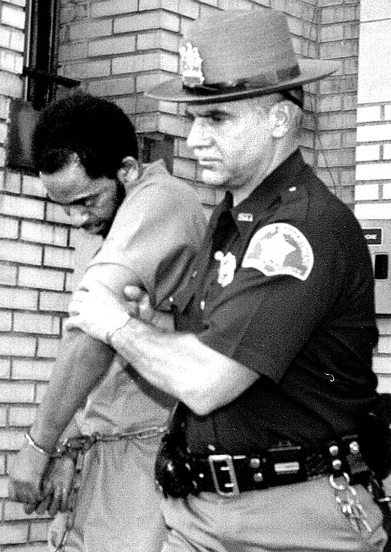 Joseph Harris being escorted by a police officer. Source: Dan Farrell/ Daily News
