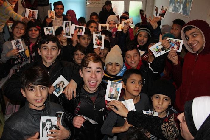 Syrian refugee children with their New Year Greetings from Letter of Love at a community centre in Gaziantep, Turkey.