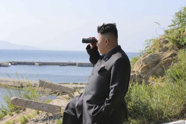 North Korean leader Kim Jong Un looks through a pair of binoculars during an inspection of the defence detachment on Ung Islet, which is defending an outpost in the East Sea of Korea, in this undated photo released by North Korea's Korean Central News Agency (KCNA) in Pyongyang July 7, 2014. REUTERS/KCNA (NORTH KOREA - Tags: POLITICS MILITARY) ATTENTION EDITORS - THIS PICTURE WAS PROVIDED BY A THIRD PARTY. REUTERS IS UNABLE TO INDEPENDENTLY VERIFY THE AUTHENTICITY, CONTENT, LOCATION OR DATE OF THIS IMAGE. FOR EDITORIAL USE ONLY. NOT FOR SALE FOR MARKETING OR ADVERTISING CAMPAIGNS. THIS PICTURE IS DISTRIBUTED EXACTLY AS RECEIVED BY REUTERS, AS A SERVICE TO CLIENTS. NO THIRD PARTY SALES. NOT FOR USE BY REUTERS THIRD PARTY DISTRIBUTORS. SOUTH KOREA OUT. NO COMMERCIAL OR EDITORIAL SALES IN SOUTH KOREA