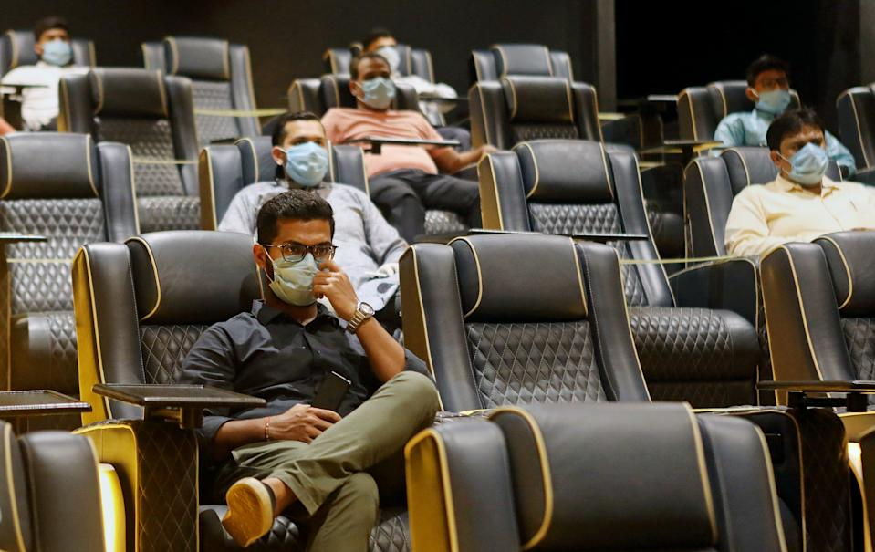 MUMBAI, INDIA - 2020/11/15: People wearing face masks as a precaution are seen at Metro Inox Cinema hall. Due to the coronavirus pandemic, cinema halls are sanitized before and after every show as a precaution to curb the spread of the virus. (Photo by Ashish Vaishnav/SOPA Images/LightRocket via Getty Images)