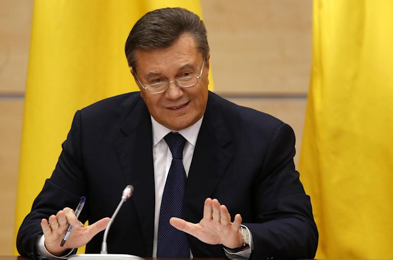Ukraine's fugitive President Viktor Yanukovych gives a news conference in Rostov-on-Don, a city in southern Russia about 1,000 kilometers (600 miles) from Moscow, Friday, Feb. 28, 2014. Yanukovych has pledged to fight on for the country's future. (AP Photo/Pavel Golovkin)