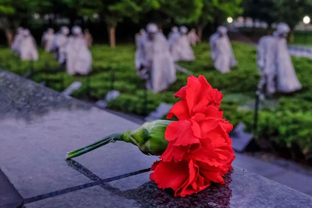 <p>A single red carnation lies on top of the mural wall at the Korean War Veterans Memorial early in the morning, May 28, 2017, during the Memorial Day weekend holiday in Washington. (Photo: J. David Ake/AP) </p>