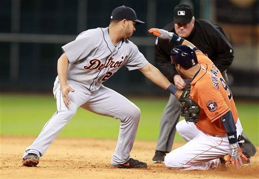 Houston Astros Marwin Gonzalez (9) slides safely into second on a double past Detroit Tigers shortstop Jhonny Peralta (27) during the seventh inning of a baseball game Friday, May 3, 2013, in Houston. (AP Photo/Patric Schneider)