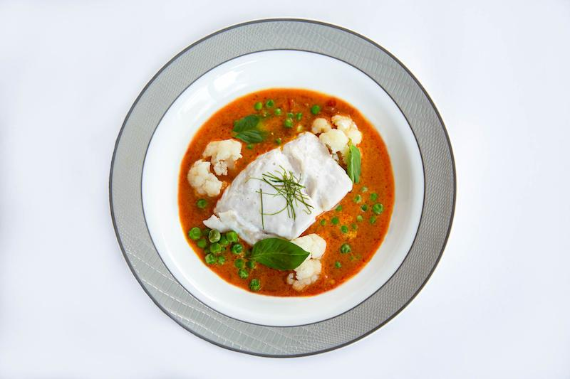 Coconut poached fish. Photo: COMO Shambhala/Singapore Airlines