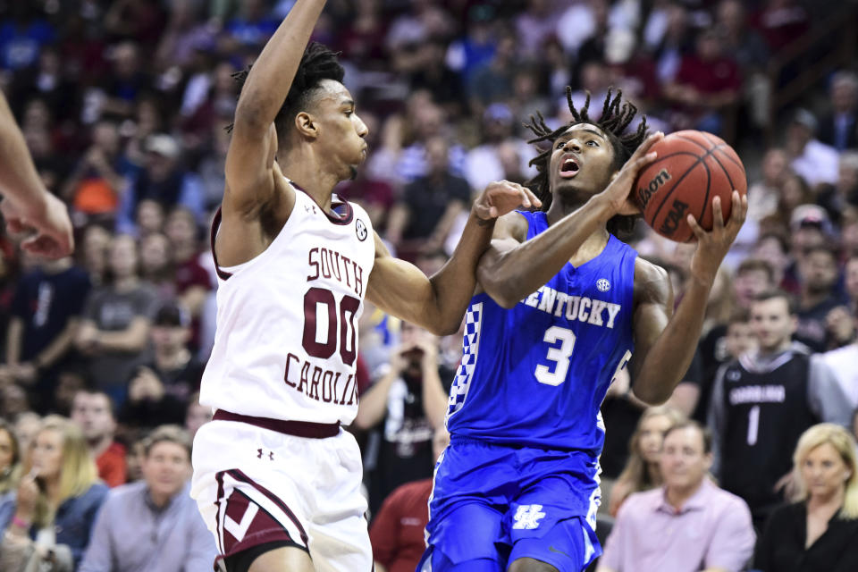 Kentucky guard Tyrese Maxey (3) is defended by South Carolina guard A.J. Lawson (00) during the first half of an NCAA college basketball game Wednesday, Jan. 15, 2020, in Columbia, S.C. (AP Photo/Sean Rayford)