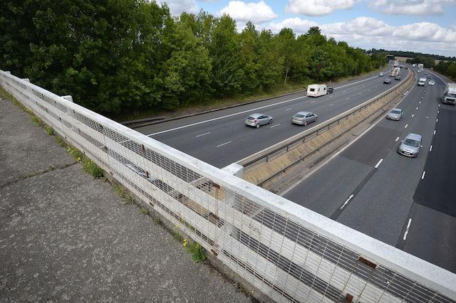"""Goose Lane bridge which goes over the M11 motorway near Birchanger which was closed after a van driver was killed in a motorway crash after what """"appears to be a lump of concrete"""" struck his windscreen and his vehicle hit a tree."""