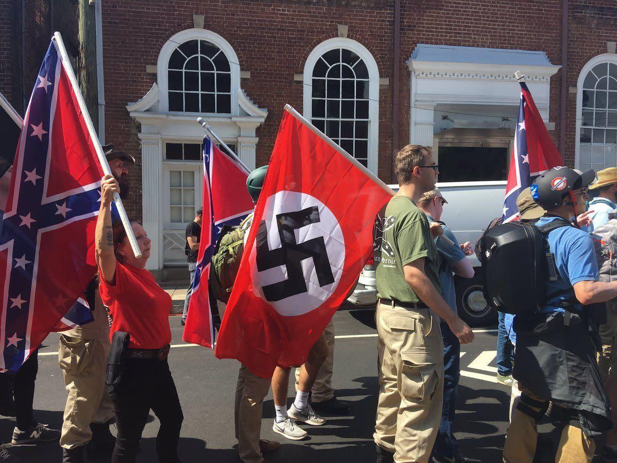White supremacists carry Naziflags on Aug. 12, 2017.