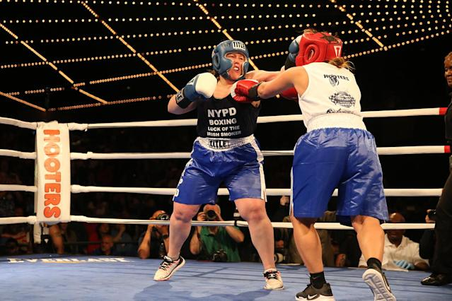 <p>Katie Walsh, left, connects with a blow off Stacy Weinstein during the NYPD Boxing Championships at the Theater at Madison Square Garden on June 8, 2017. (Photo: Gordon Donovan/Yahoo News) </p>