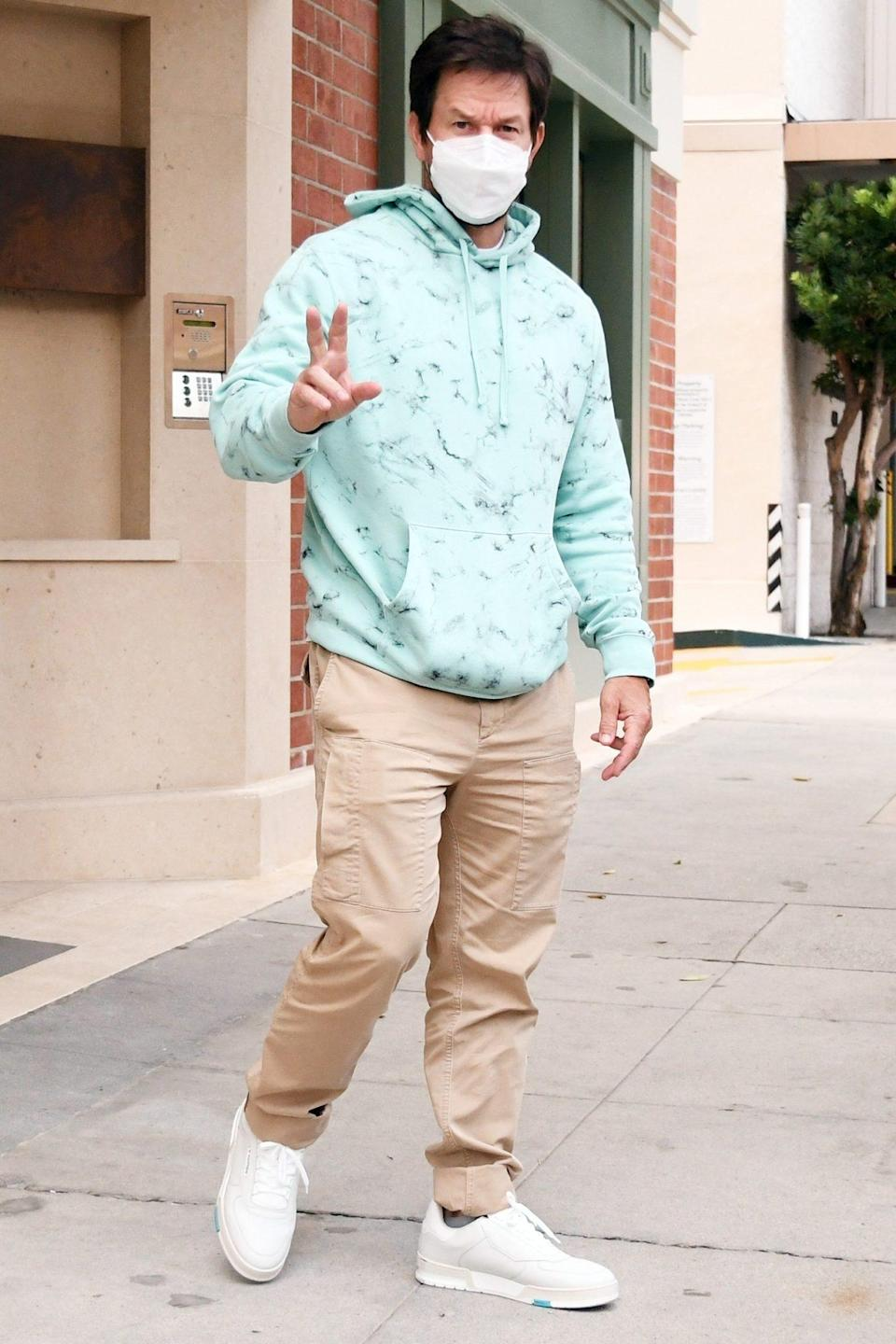 <p>Mark Wahlberg flashes a peace sign while seen leaving a doctor's office in Beverly Hills on Wednesday.</p>