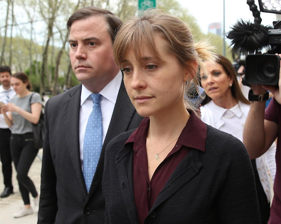 BROOKLYN, NY - MAY 04:  Actress Allison Mack (R) departs the United States Eastern District Court after a bail hearing in relation to the sex trafficking charges filed against her on May 4, 2018 in the Brooklyn borough of New York City. The actress known for her role on 'Smallville' is charged with sex trafficking. Along with alleged cult leader Keith Raniere, prosecutors say Mack recruited women to a upstate New york mentorship group NXIVM that turned them into sex slaves.  (Photo by Jemal Countess/Getty Images)