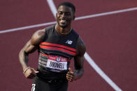 Trayvon Bromell wins the second heat of the men's 100-meter run at the U.S. Olympic Track and Field Trials Saturday, June 19, 2021, in Eugene, Ore. (AP Photo/Chris Carlson)