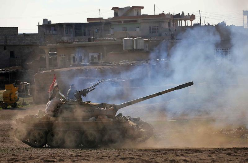 Iraqi government forces supported by fighters from the Abbas Brigade,  advance in village of Badush some 15 kilometres northwest of Mosul during the ongoing battle to retake the city's west from Islamic State group March 7, 2017