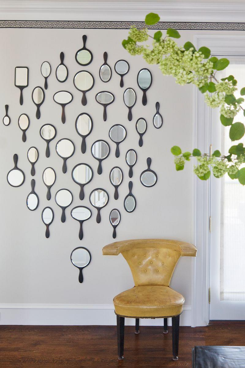 <p>A twist on the typical gallery wall? A gallery wall of antique hand mirrors. Clustered together, these simple, eclectic mirrors function as art (and reflect light beautifully). This one is comprised of hand mirrors and configured in the shape of a hand mirror. These are functional and adorable. No more convincing needed.</p>