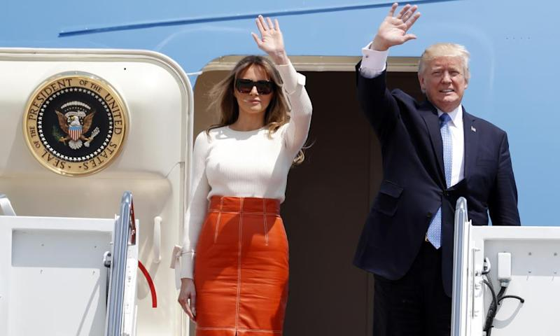 Donald and Melania Trump wave as they board Air Force One at Andrews Air Force Base in Maryland Friday.