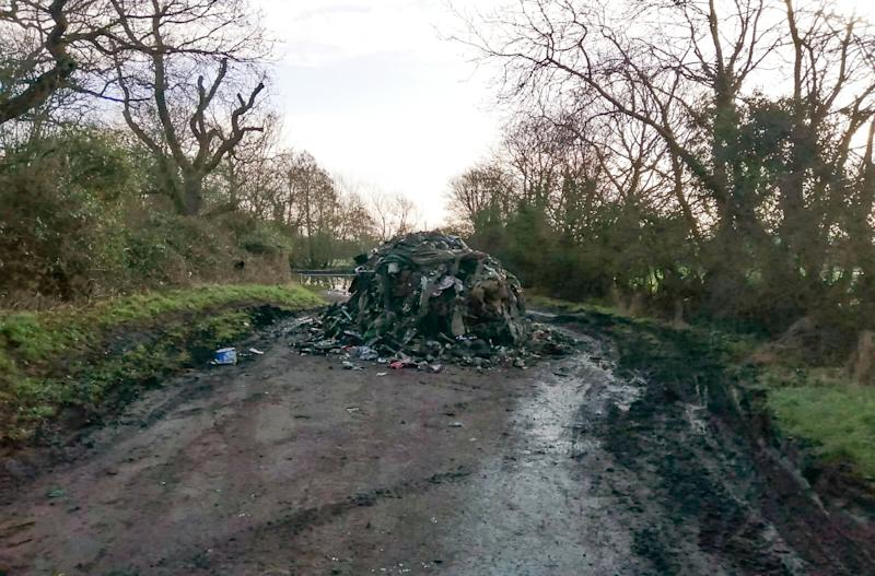 The charred rubbish has blocked the entire length of the lane (Picture: SWNS)