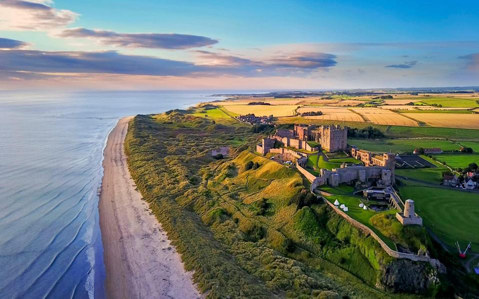 There's no avoiding Bamburgh Castle, which seems to fill the sky as it rises some 150ft on its volcanic outcrop - Yin Sun/Visit Britain