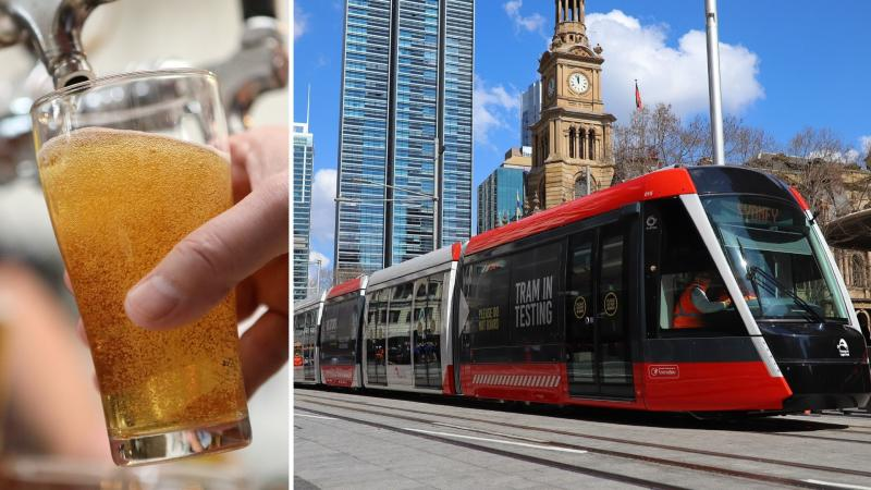 A glass of beer on the left and a new Sydney tram running down George St on the right.