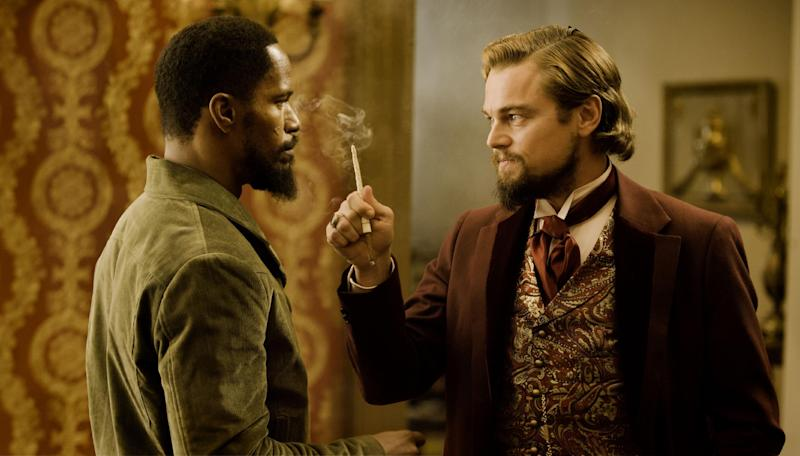 """In this undated publicity photo released by The Weinstein Company, from left, Jamie Foxx as Django and Leonardo DiCaprio as Calvin Candle star in the film, """"Django Unchained,"""" directed by Quentin Tarantino.  (AP Photo/The Weinstein Company, Andrew Cooper, SMPSP, File)"""