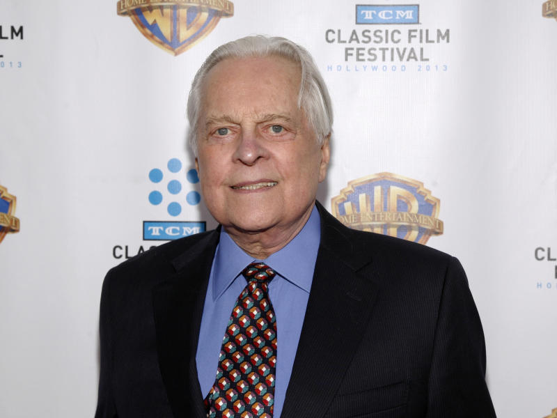 "FILE - This Jan. 31, 2013 file photo shows Turner Classic Movies host Robert Osborne attending the ""Cabaret"" 40th anniversary screening in New York. A collection of Hollywood memorabilia belonging to Osborne will be auctioned off on Oct. 10.  (Photo by Andy Kropa/Invision/AP, File)"