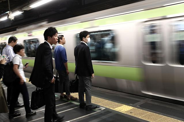Millions of people use Japan's transport system every day. (Photo credit should read BEHROUZ MEHRI/AFP/Getty Images)