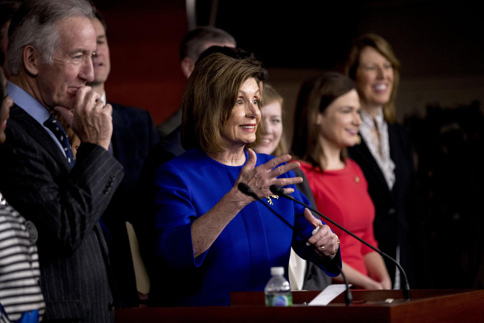 House Speaker Nancy Pelosi of Calif., accompanied by Chairman of the House Ways and Means Committee Richard Neal, D-Mass., left, speaks at a news conference to discuss the United States Mexico Canada Agreement (USMCA) trade agreement, Tuesday, Dec. 10, 2019, on Capitol Hill in Washington. (AP Photo/Andrew Harnik)