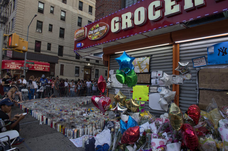 The Bronx bodega from which Guzman-Feliz was dragged to his death became a memorial to the teenager. (Andrew Lichtenstein via Getty Images)