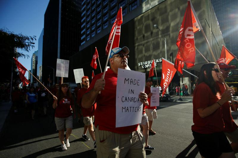 Members of Canada's Unifor union march during a rally ahead of the third round of NAFTA talks in Ottawa